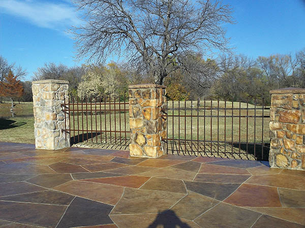 Man-made stone columns faded from sun exposure, renewed with CPI Silane Siloxane